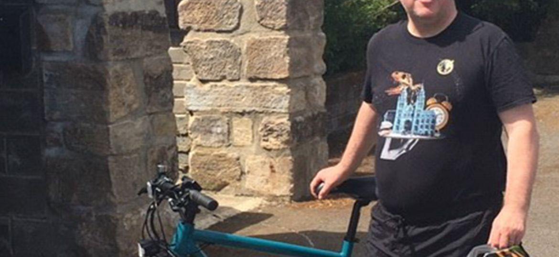 a men next to the bike on the scheme